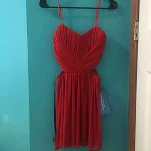 Dresses & Skirts - Red mini dress with cut outs